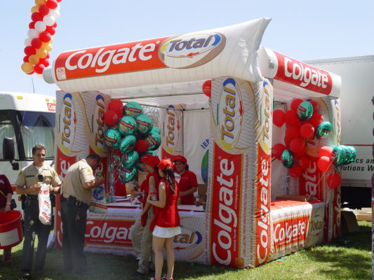 booth for colgate outdoor sampling promo event with inflatable design